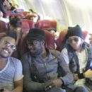 Black Eyed Peas performing on a Virgin Blue flight - 454 x 340