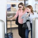Olivia Wilde – Arrives at LAX Airport in Los Angeles