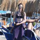 Lily Collins in Black Bikini at the beach in Ischia - 454 x 681