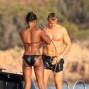 Naomi Campbell In Black Bikini On Boat In Sardinia, Italy - Aug 8 2009