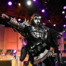 Musician Gene Simmons of KISS performs onstage during the 23rd Annual Race To Erase MS Gala at The Beverly Hilton Hotel on April 15, 2016 in Beverly Hills, California - 454 x 306
