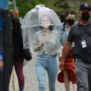 Rachel Brosnahan – AWith her HEPA filter clear umbrella in New York