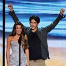 Lea Michele (L) and Tyler Posey speak onstage during the 2012 Teen Choice Awards at Gibson Amphitheatre on July 22, 2012 in Universal City, California