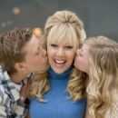Lynn-Holly Johnson gets kisses from her son Kellen, left, and daughter Jensie, at their Newport Beach home - 454 x 340