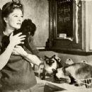 Amanda Blake and cats, 1961