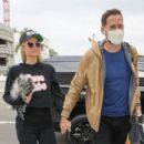 Paris Hilton and Carter Reum – Seen at a airport
