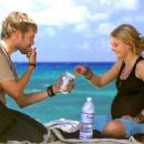 Emilie De Ravin is Claire and Dominic Monaghan is Charlie on Lost. - 454 x 254