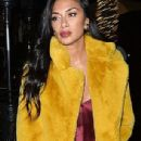 Nicole Scherzinger looks sensational as she colour blocks in a bold yellow coat and plum silk dress for a glam dinner date