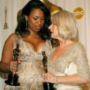 Best Actress winners Jennifer Hudson and Helen Mirren with their statuettes at the 79th Annual Academy Awards - 411 x 594