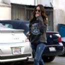 Megan Fox hides her face as she leaves out of the back door of a skin care center in Hollywood. 12/06/2011