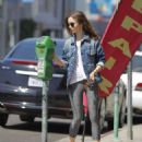 Lily Collins feeding the parking meter in Beverly Hills - 454 x 559