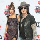 Nikki Sixx and Courtney Sixx attend the iHeartRadio Music Awards at The Forum on April 3, 2016 in Inglewood, California. - 449 x 600