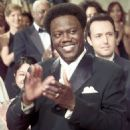 Running mate Mitch Gilliam (Bernie Mac) proudly applauds his brother, Presidential candidate Mays Gilliam