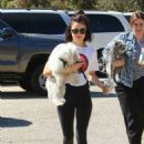 Lucy Hale – Taking her dog Elvis to a park in Los Angeles - 454 x 636