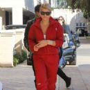 Sofia Richie in a matching red tracksuit out in Beverly Hills