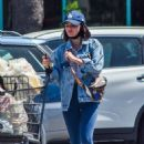 Lucy Hale – Grocery shopping in jeans jacket and skintight leggings in Los Angeles