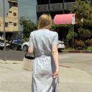 Dakota Fanning – Leaving the farmers market in Studio City - 454 x 681