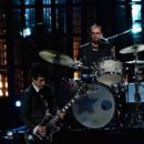 Inductee Ringo Starr performs onstage during the 30th Annual Rock And Roll Hall Of Fame Induction Ceremony at Public Hall on April 18, 2015 in Cleveland, Ohio. - 399 x 600