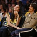 That's one Red Hot smooch! Anthony Kiedis, 52, shares passionate courtside kiss with Brazilian model Wanessa Milhomem, 22, at the LA Lakers game - 454 x 322