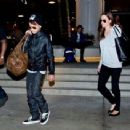 Angelina Jolie & Maddox Arriving At LAX (February 14, 2014))