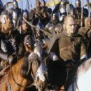 (right) Legolas (Orlando Bloom) joins with Rohan warriors to fight against Sauron in New Line Cinema's epic adventure, The Lord of the Rings: The Return of the King.
