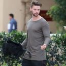 Patrick Schwarzenegger out for lunch with a friend at the Bouchon restaurant in Beverly Hills, California on December 17, 2014 - 430 x 594