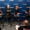Glenn Tipton, Rob Halford and Richie Faulkner of the band Judas Priest along with host Jim Breuer attend SiriusXM's Town Hall series with Judas Priest on July 8, 2014 in New York City.