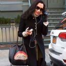 Famke Janssen in Black Coat Shopping in New York