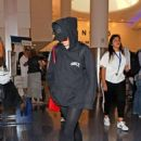 Maisie Williams at LAX Airport in LA July 12, 2017 - 454 x 645