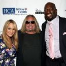 Jenn Brown, Vince Neil, and Titus O'Neil attend the 16th Annual Waiting for Wishes Celebrity Dinner Hosted by Kevin Carter & Jay DeMarcus on April 18, 2017 in Nashville, Tennessee.