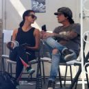 Rocker Tommy Lee and his fiance Sofia Toufa stop by a car wash in Calabasas, California on May 12, 2016. Tommy sat by himself and sent some text messages before returning to Sofia's side - 454 x 507
