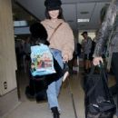 Vanessa Hudgens and Austin Butler at LAX Airport in LA - 454 x 695