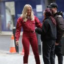 Louisa Johnson – Spotted in red with suede knee boots in London