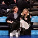 Dakota Fanning and Henry Frye at New York Knicks vs Milwaukee Bucks game in NYC - 454 x 427