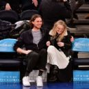Dakota Fanning and Henry Frye at New York Knicks vs Milwaukee Bucks game in NYC