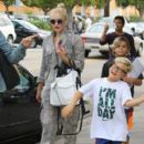 Gwen Stefani is spotted taking her sons Apollo, Zuma, and Kingston to church in Los Angeles, California on October 4, 2015