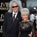 Brian May and Anita Dobson attend The Olivier Awards at The Royal Opera House on April 12, 2015 in London, England. - 408 x 600