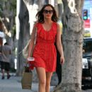 Rose McGowan looked great in a short red dress as she went shopping at the Curve in Beverly Hills, California on July 11, 2012