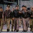 American military service personnel in the Pacific prepare for war, including (left to right) Colonel Doolittle's co-pilot (Paul Francis), Danny Walker (Josh Hartnett), Red (Ewen Bremner, background), Rafe McCawley (Academy Award®-winner Ben Affleck),