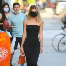 Emily Ratajkowski in a black strapless dress as she heads to dinner in New York