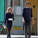 Actress Kirsten Dunst and a male friend out for lunch in Toluca Lake, California on March 20, 2012