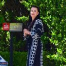 Kyle Richards – Stepped out of her house in a chic robe in Beverly Hills