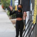 Teala Dunn – Shows toned abs after workout at Dogpound in West Hollywood