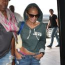 Kristin Chenoweth departing on a flight at LAX airport in Los Angeles, California on September 4, 2015 - 454 x 591
