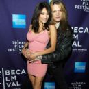 Sebastian Bach & Maria attend the premiere of RUSH: Beyond the Lighted Stage during the 2010 Tribeca Film Festival on April 24, 2010 in New York