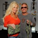 Musician Vince Neil (L) and wife Lia Gherardini pose in the Official Silver Spoon Gifting Lounge held during the 2008 American Music Awards at the Nokia Theatre on November 22, 2008 in Los Angeles, California