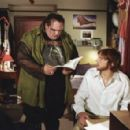 Ethan Suplee (left) and Ashton Kutcher (right) star in New Line Cinema's thriller, The Butterfly Effect.