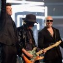 Singer Robin Thicke, musician Joe Perry and rapper Pitbull perform onstage during The 58th GRAMMY Awards at Staples Center on February 15, 2016 in Los Angeles, California. - 454 x 302
