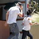 Vanessa Hudgens and Austin Butler were hard at work yesterday, June 22, moving items out of Vanessa's home in Los Angeles