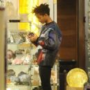 Jaden Smith puts his arms around Kylie Jenner and shows her an item while shopping together at Crystalarium on Tuesday (November 19) in West Hollywood, Calif - 454 x 663